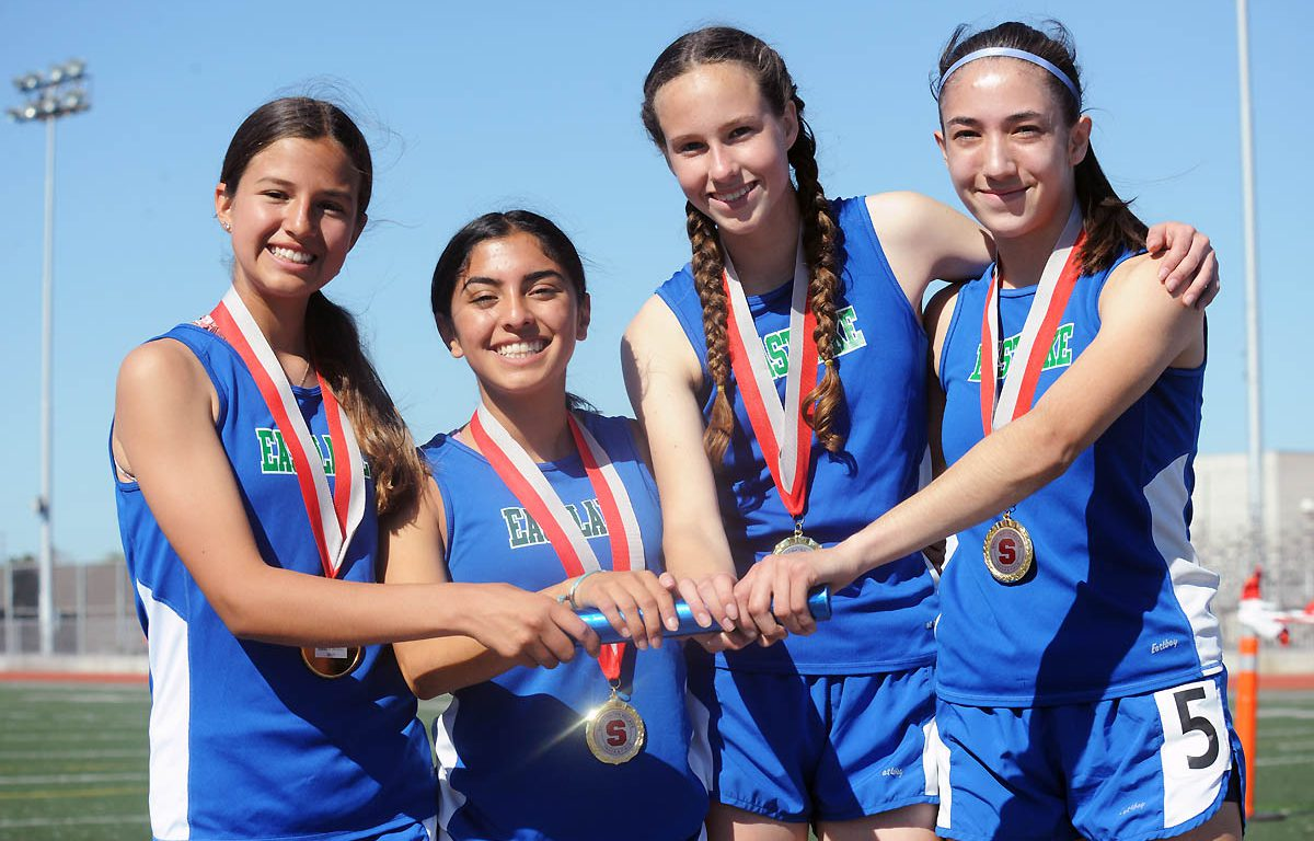 Eastlake girls distance medley relay winners, from left, Tatum Sherard, Bella Alcocer, Kate Robinson and Luz Mercado. Photo by Phillip Brents