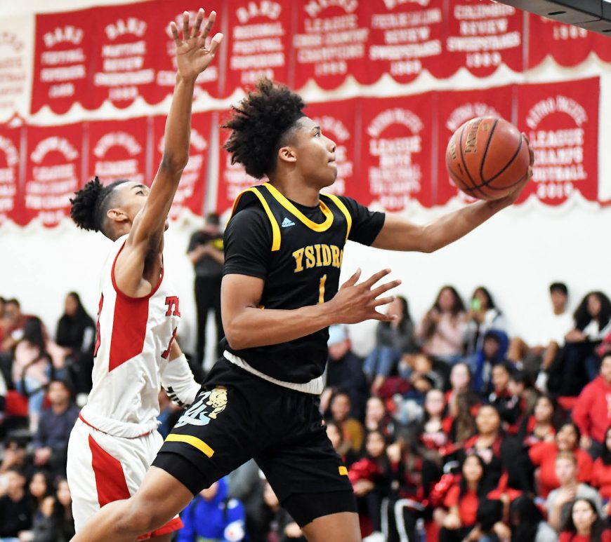 San Ysidro freshman Mikey Williams flies toward the basket in Wednesday's South Bay League game at Castle Park. Photo by Phillip Brents (Star News)
